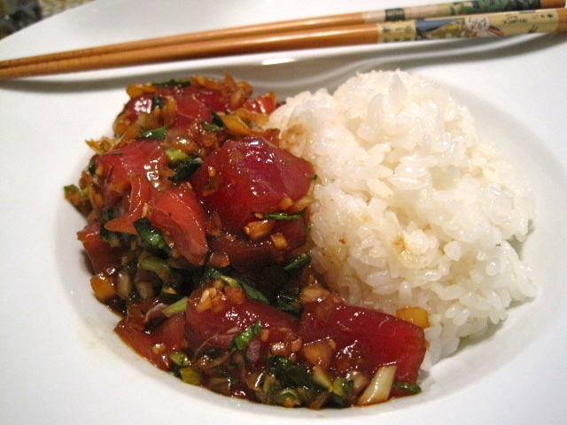 "Ain't no hokey-pokey, let me tell you - Hawaiian Ahi tuna ""poke"" with rice wine vinegar sweetened Japanese rice. Ahi tuna served cold and rare in a lovely marinade of onion, ginger, garlic, green onion, kale, chili sauce, soy sauce, Hawaiian alaea salt, sesame oil and toasted sesame seeds. I am totally eating this right now."