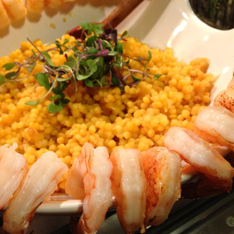 Saffron Israeli couscous in white wine served with sauteed shrimp spritzed with lime and sea salt